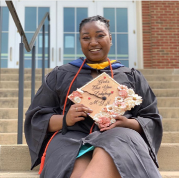 2020 graduate Danielle Norris celebrates her accomplishments and her degree from UMW's College of Business.