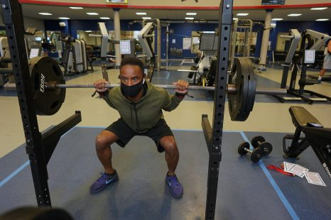UMW employee Andre Reaves lifts weights in the UMW Fitness Center, which has spaced apart its workout equipment and is sanitizing between uses. Photo by Suzanne Carr Rossi.
