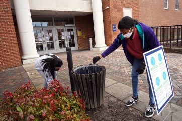 Senior Jaelynn Scott (left) and sophomore Sha'Lelia Moore (right) pick up litter on the UMW campus during the MLK Day of Service. Photo by Suzanne Carr Rossi.