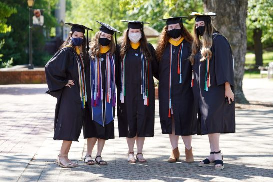 Donning decorated caps and colorful honors tassels, as well as the accessory of the year - protective masks - 2021 grads said goodbye to the Mary Washington campus and the friends they made over the last four years. Photo by Suzanne Carr Rossi.