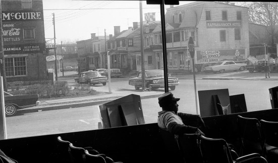 A man sits inside Fredericksburg's bus depot in 1965. The nearby Hotel McGuire and Rappahannock Hotel were listed in the Green Book, a guide that helped Black travelers find safe accommodations. Photo credit: File / The Free Lance-Star.