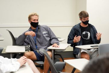 Freshmen Carter Berg (left) and Jack Collier share their thoughts during the Common Experience discussion group. Photo by Suzanne Carr Rossi.