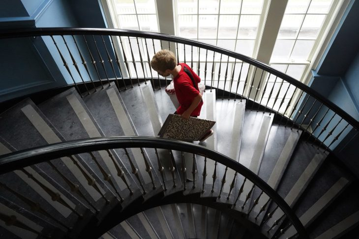 A student ascends the spiral staircase during UMW Move-In Day, which welcomed undergrads from as far away as South Africa. Photo by Suzanne Carr Rossi.