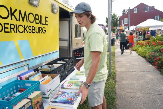 Hollis Cobb refurbished an old ambulance into a mobile library. Photo by Suzanne Carr Rossi.