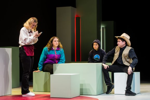Shannon Hardy (L) as Barbara waits on a family of out-of-towners from Montana, portrayed by Amelia Emory, Maddie Baylor and Oscar León, who all play multiple roles in 'Nickel and Dimed.' Photo by Geoff Greene.