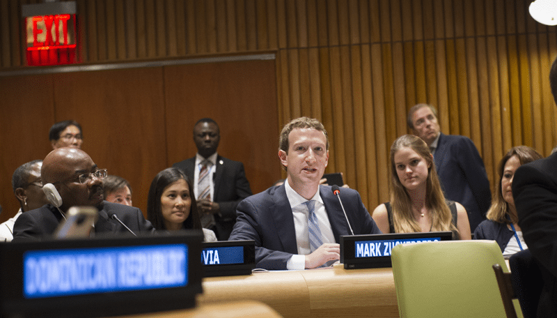 "Mark Zuckerberg (centre), CEO of Facebook Inc., addresses the interactive dialogue of the Summit for the adoption of the post-2015 development agenda, ""Fostering sustainable economic growth, transformation and promoting sustainable consumption and protection"", held at UN Headquarters. UN Photo: Mark Garten"