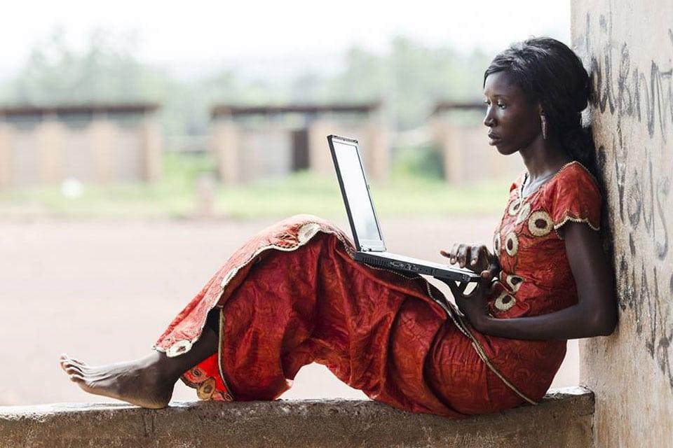 Photo: A woman uses a laptop computer.