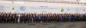 Photo: Participants in Day 2 of the COP21 proceedings pose for photos.