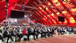Participants at the COP21 in Paris celebrate the adopted agreement on 12 December.
