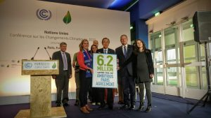 Photo: Ban Ki-moon stands with Nobel Peace Laureate Al Gore during a civil society event 10 December in Paris.