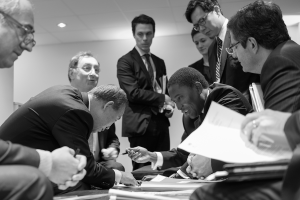 Photo: Secretary-General Ban Ki-moon (second left), discusses draft text with his advisors before meeting with the president of the UN Climate Change Conference in Paris, France (COP21) on 12 December.