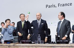 Photo: Laurent Fabius (second right), Minister for Foreign Affairs of France and President of the UN Climate Change Conference in Paris, gavels in the Paris Agreement on 12 December.