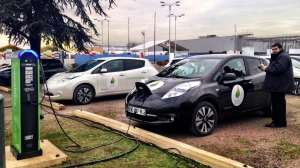 Recharging electric cars sit in the COP21 parking lot.