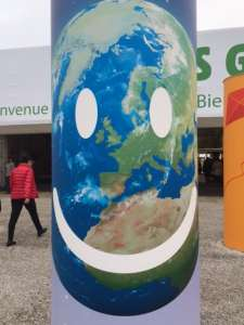 Photo: A smiling earth graphic greets COP21 attendees in Paris on 1 December.