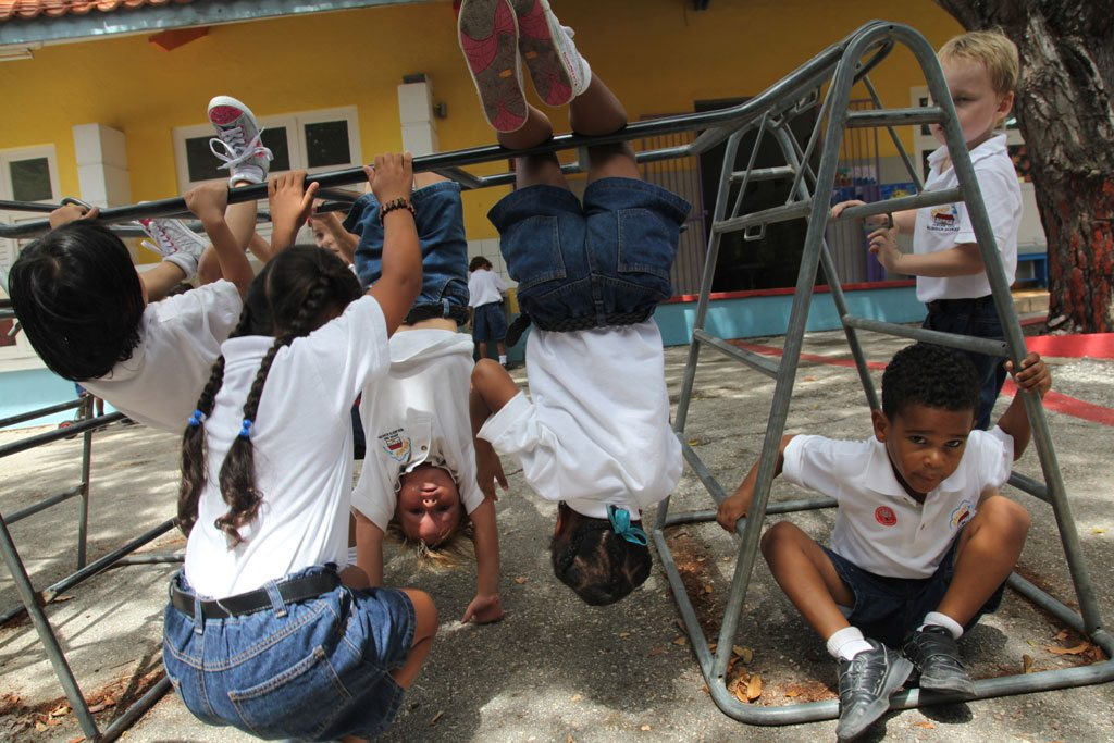 Photo: Children play outdoors at a school in Curaçao.