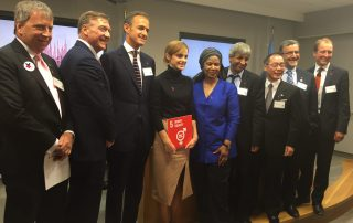 Photo: HeForShe Goodwill Ambassador Emma Watson (center) holds the Goal 5 Gender Equality icon next to UN Women Executive Director Phumzile Mlambo-Ngcuka and surrounded by the presidents of top universities.
