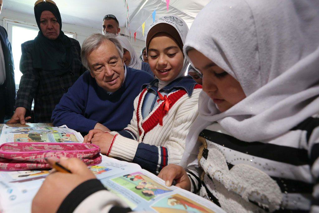 In Jordan, Mr. Guterres speaks with schoolchildren during a visit to the Zaatari refugee camp in March 2017. UN Photo/Sahem Rababah