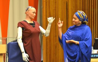 "Photo: Deputy Secretary-General Amina Mohammed interacts with Sophia the robot at the ""The Future of Everything – Sustainable Development in the Age of Rapid Technological Change"" meeting."