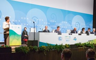Photo: Patricia Espinosa, Executive Secretary of the UN Framework Convention on Climate Change (UNFCCC), at podium, addressing the opening ceremony of the Bonn Climate Conference.