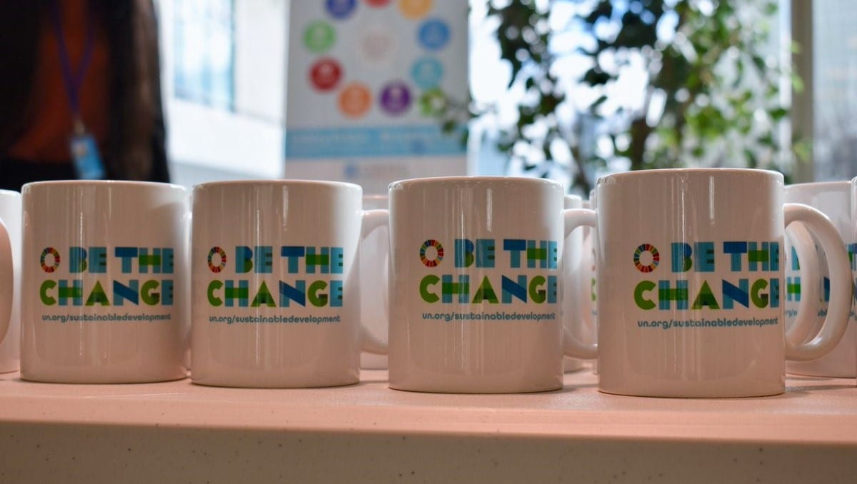 """Be the Change""-branded mug"