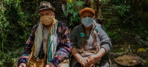 Image of two indigenous people wearing face masks