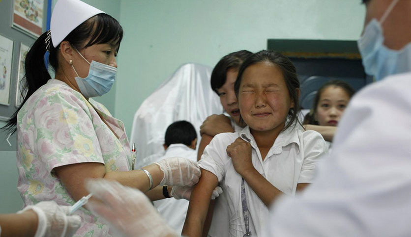 A young girl is immunized against measles at a school in Mongolia. UNICEF/B. Sokol