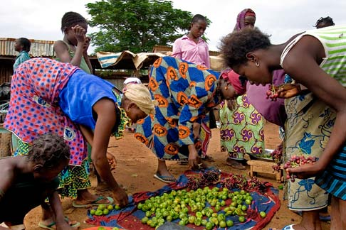 Women buying fruit in a downtown market in Ouagadougou, Burkina Faso.