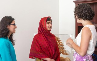 Malala Yousafzai (centre) with Olivia Curl (left) and Lena Shareef, creators of #GirlWithABook. UN Photo/Mark Garten