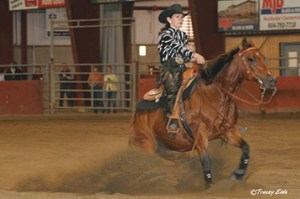 Carla Webb doing sliding stop in reining event