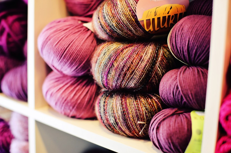 Colorful yards of yarn on display at the store.