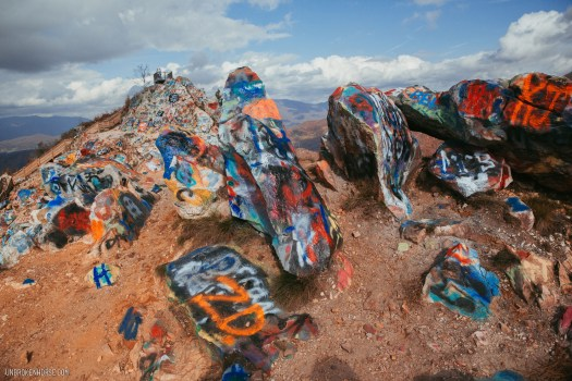 Graffiti is allowed on Bell Mountain - and attracts lots of visitors with spray cans