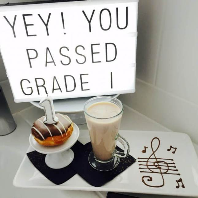 Hot chocolate, donuts and a light box to celebrate a Grade 1 piano pass
