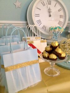 Cinderella treat party bags created using white voile and gold washi tape. Fill with sweet treats and enjoy during your panto or theatre trip.