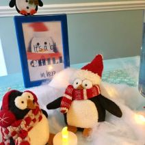 Check these two penguin dudes out, chilling and catching up around their campfire