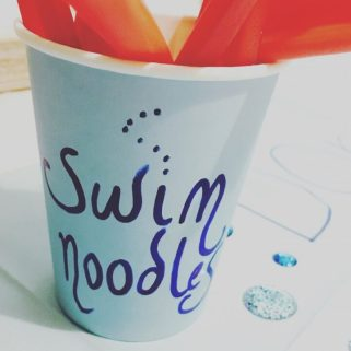 Swim party sweet treat ideas. Use paper cups to hold your swim noodles.