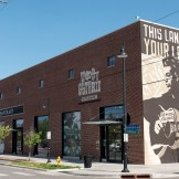 The outside of the Woody Guthrie Center - Photo by Dennis Spielman