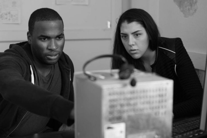 Josh Bonzie and Lauren Analla in character studying a monitor. ©2016 Planet Thunder  Productions, photo by Zachary Burns (producer)