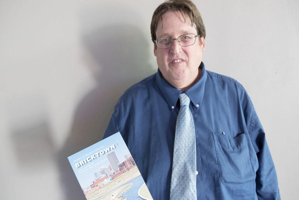 Steve Lackmeyer holding his book - photo by Dennis Spielman