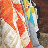 Quilts on Fence photo by Amanda Lipscomb