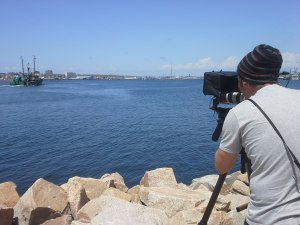 DP Daniel Cojanu films the F/V Huntress as it departs New Bedford Harbor with a crew of SMAST researchers.
