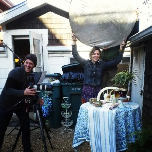 Daniel Cojanu (left) and Rainy Day store owner Heather Kochin on the set. Look closely and you'll see set designer Jen McKeon's husband, Kevin, behind the bounce.