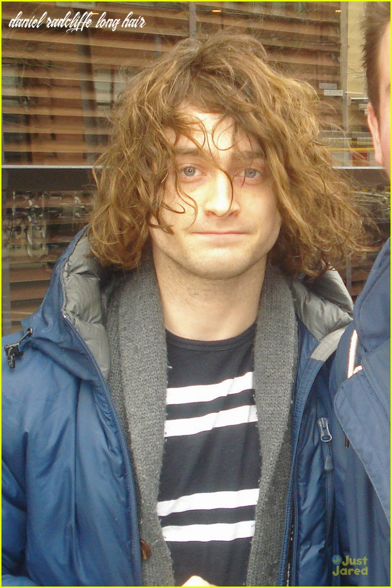 Full sized photo of daniel radcliffe covers long hair with topper