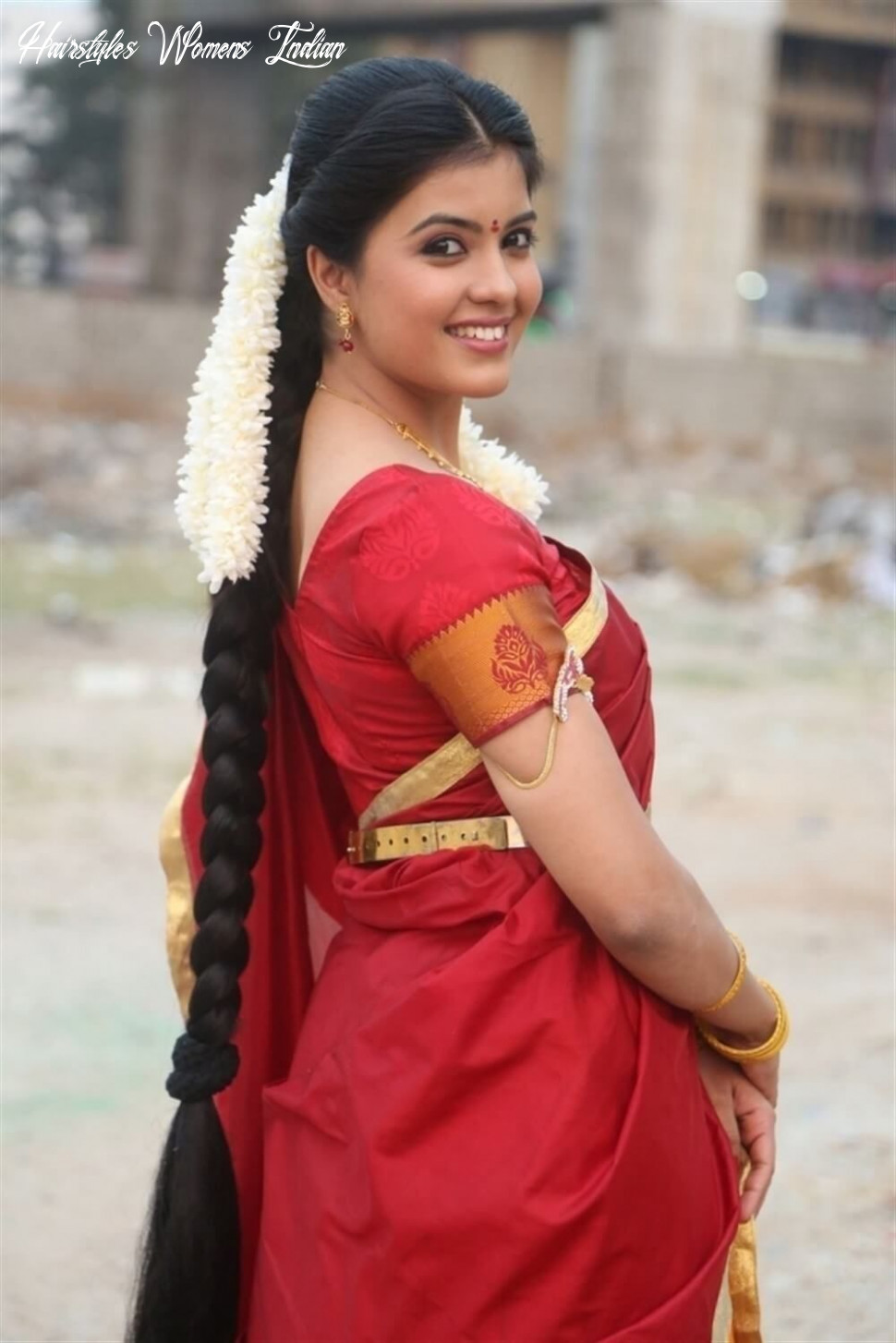 South indian woman with long braid and fresh jasmines in her hair