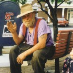 Poppa Neutrino sits on a park bench