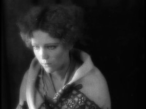 Woman in silent movie looking forlorn