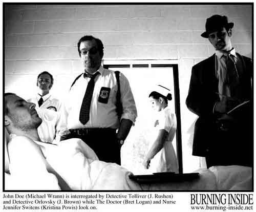 officials interrogate john doe michael wrann in the hospital