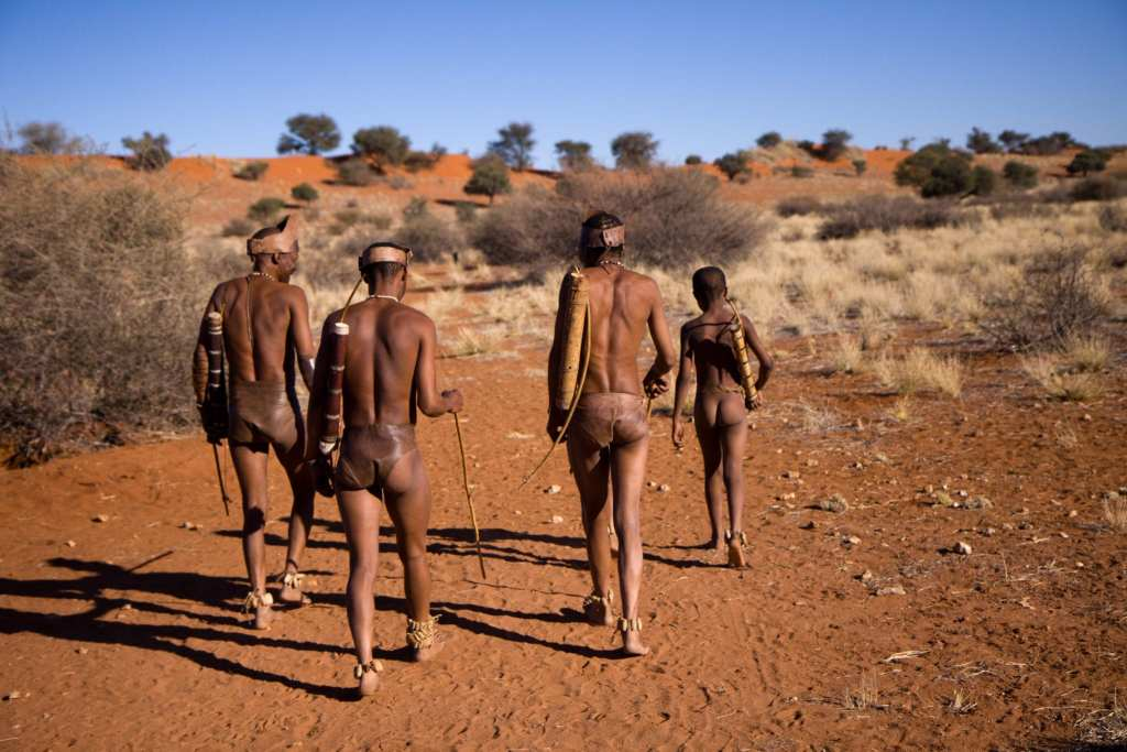 San people show people how they live in the Kalahari Desert in Namibia | © Franco Lucato/Shutterstock