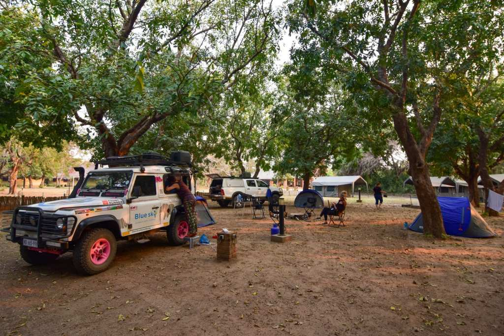 Setting up camp in Gorongosa National Park's recently refurbished Chitengo campsite | © Emily Scott/ Blue Sky Society