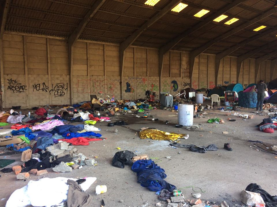 "An abandoned warehouse where the majority of displaced people in Grande-Synthe have been sleeping over the winter. ""Social distancing"" in these conditions is impossible. 