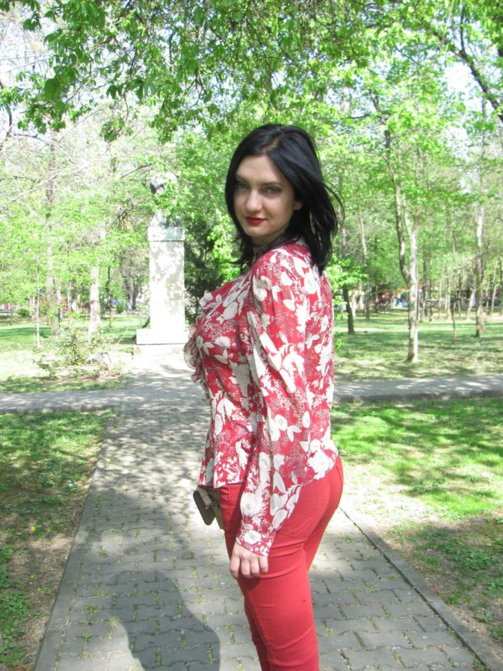young woman wearing red outfit